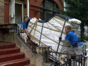 our team moving piano to a house - piano movers near me