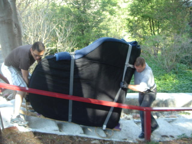 piano land team working on moving a piano - new york piano movers