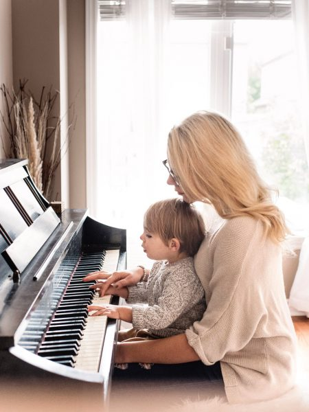 woman giving piano lesson to a kid after piano tune ups